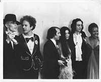 thumbnail link to original b&w photo David Bowie, John Lennon, Simon and Garfunkel, Roberta Flack back stage Grammys 1975