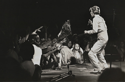 thumbnail link to original 1974 press photograph David Bowie on stage by Terry O'Neill.