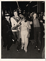 thumbnail link to original 1973 press photo David Bowie chased at Charing Cross station.