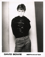 thumbnail link to original David Bowie RCA 1977 still, Sukhita Heroes shot, leather jacket on backwards