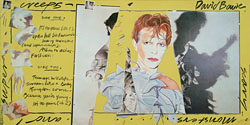 thumbnail link to original David Bowie Scary Monsters large RCA in-store display, yellow version.