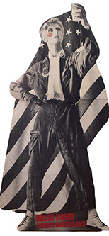 thumbnail link to original David Bowie 1975 full-size card in-store standee, American flag, flying suit, glass of milk aloft.