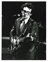 thumbnail link to original c.1977 Andre Csillag photograph of Elvis Costello