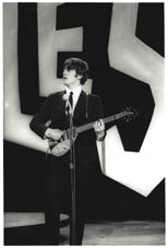 thumbnail link to original 1964 Ken Regan photo of John Lennon on the Ed Sullivan show