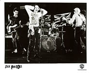 Original 1977 Warner Bros. Records promo still, Sex Pistols filming God Save the Queen video at Marquee Club by Dennis Morris