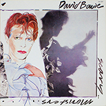 thumbnail link to original David Bowie Scary Monsters smaller in-store card flat display.