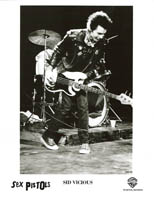 Original 1977 Warner Bros. Records Sex Pistols promo still, Sid Vicious on stage